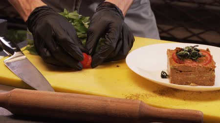 Chef Puts The Cut Cherry Tomato On A Plate Stock Footage