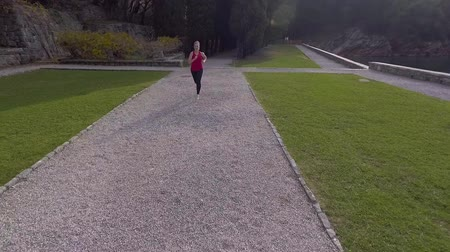 Beautiful Young Girl Athlete Running in Park Stock Footage