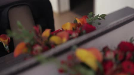 Cute Bouquet Of Red Flowers And Small Red Apples Stock Footage