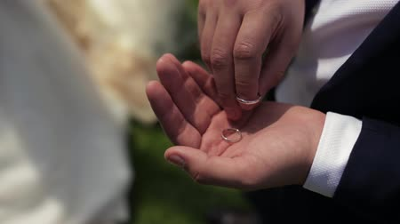 Nervous Groom Touches The Engagement Rings