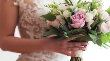 Bride In Luxury Dress Is Holding Bright Bouquet