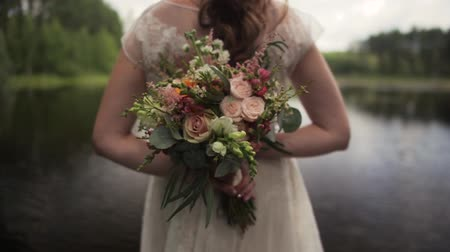 Bride In A Boho Wedding Dress Holding A Bouquet