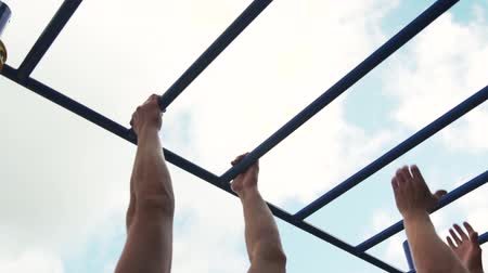 horizontal bar : Two Muscular Men Training in Street Workout Ground