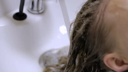 conditioner : Close-up - Hairstylist Washing Female Hairs Before Doing a Hairdo. Stock Footage