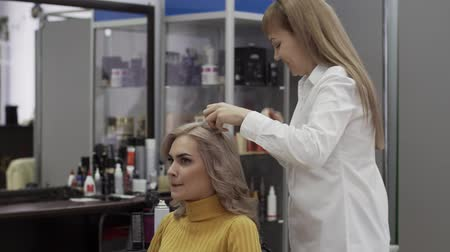 splendid : Positive Woman Hairdresser Make A Voluminous Beautiful Hairstyle Stock Footage
