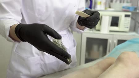 woman waxing : Close up Hands Of A Female Epilation Master
