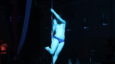 striptérka : THESSALONIKI, GREECE, MAY 30, 2015: Unknown dancer During the Pole Battle Tricks 2015. it is the 1st time in Thessaloniki Greece at WE sport  culture complex.