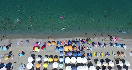 panoramic view : Aerial view of the beach of Leptokaria in Greece. colorful umbrellas and people who swims. Aerial shot