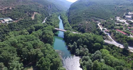 гражданский : Aerial view of the bridge and the road over the river Pinios in the green valley of Tempe in Greece