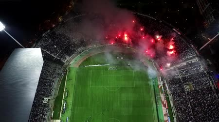 kibice : Thessaloniki, Greece, Sept 23 2015: Aerial flying by soot of the Toumba Stadium full of fans during a football match for the championship between teams PAOK vs AEK