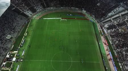 estádio : Thessaloniki, Greece, Sept 23 2015: Aerial flying by soot of the Toumba Stadium full of fans during a football match for the championship between teams PAOK vs AEK
