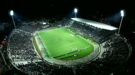 estádio : Thessaloniki, Greece, October 4 2015: Aerial flying by soot of the Toumba Stadium full of fans during a football match for the championship between teams PAOK vs Olympiacos Stock Footage