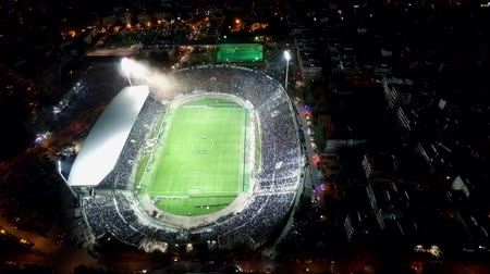 kibice : Thessaloniki, Greece, October 4 2015: Aerial flying by soot of the Toumba Stadium full of fans during a football match for the championship between teams PAOK vs Olympiacos Wideo