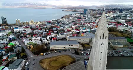 hallgrimskirkja : Reykjavik, Iceland - April 1, 2017: Aerial view of famous Hallgrimskirkja Cathedral and the city of Reykjavik in Iceland. Image taken with action drone camera Stock Footage