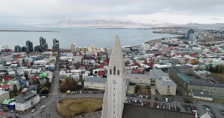 hallgrimskirkja : Aerial view of famous Hallgrimskirkja Cathedral and the city of Reykjavik in Iceland. Image taken with action drone camera Stock Footage