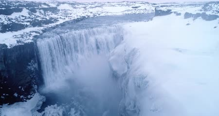 Aerial flight with drone over the famous Dettifoss is a waterfall in Vatnajokull National Park in Northeast Iceland, and is reputed to be the most powerful waterfall in Europe