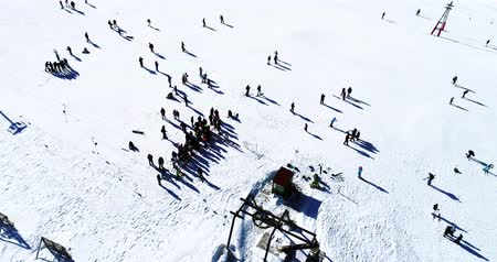Vasilitsa, Greece - January 5, 2018: Aerial View of skiers at Ski Resort Vasilitsa in the mountain range of Pindos, in Greece. The ski resorts currently has 5 lifts and 16 ski trails Stok Video