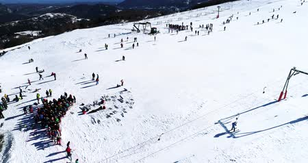 Vasilitsa, Greece - January 5, 2018: Aerial View of skiers at Ski Resort Vasilitsa in the mountain range of Pindos, in Greece. The ski resorts currently has 5 lifts and 16 ski trails Stock Footage