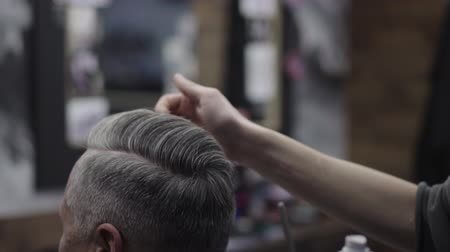 beard trimming : hairdresser cuts a mans hair close-up Stock Footage