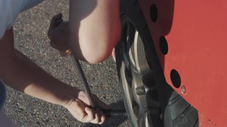 motorcar : Mechanics change the wheel on a racing car Stock Footage