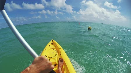 kayak : the guy swims on a kayak in the ocean Stock Footage
