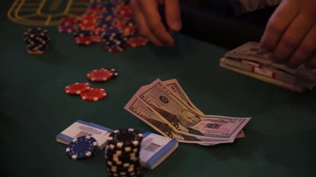 último : chips and counterfeit money on casino table, playing roulette.