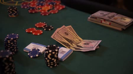 geçen : chips and counterfeit money on casino table, playing roulette.