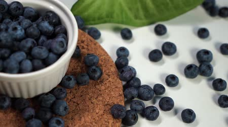 bilberry : Heap of fresh blueberries in white bowl. Closeup shot. Fresh berry series Stock Footage