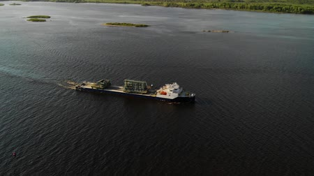ithalat : Large ship with cargo at the river - side aerial view