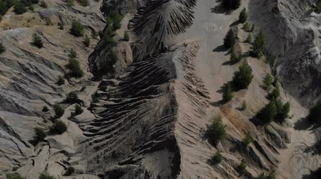 caravan : Aerial footage of gray mountains and ravine. Great top view on a canyon with gray mountains. Another planet footage