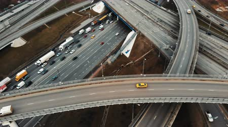 csomópont : Aerial drone flight over road traffic. Moving taxi on the road junction