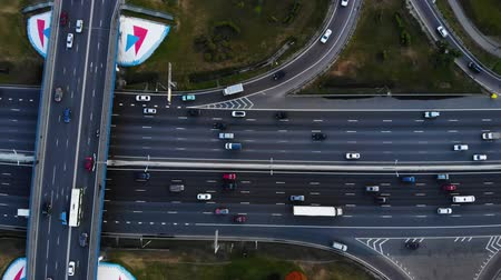 toll : Aerial view of a motorway. Camera move slow left. A lot of cars ride on the 10 lanes motorway.