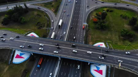 wozek : Aerial view of a motorway. Camera move back with a view on car interchange. A lot of cars ride on the 10 lanes motorway.