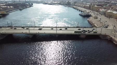 vízpart : Aerial view of a huge car bridge with cars drive on it with sun shining in camera, nice above footage.