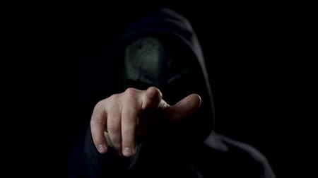 invisible : Man in a black room in skull mask. Scary man in mask pointing finger on you or in camera. Spooky footage.