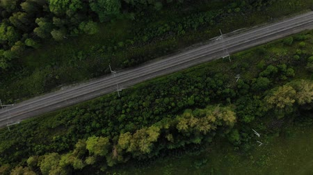 arborizado : Aerial view of the railroad tracks, the camera revolves around the tracks.