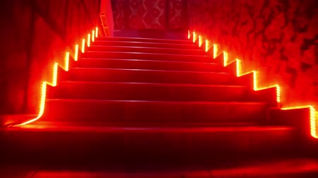 Climbing up the stairs in a nightclub