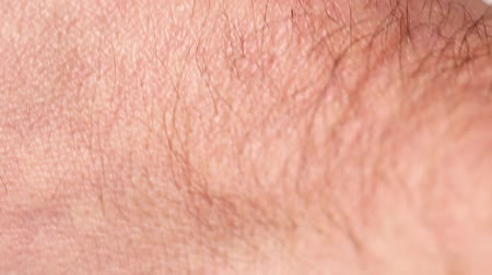 Skin of an adult man with hair closeup Stock Footage