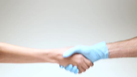 olá : Handshake people on a white isolated background. Close-up.