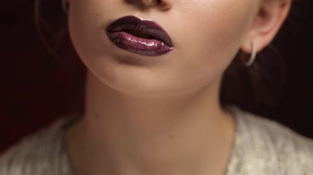Portrait of a cute girl with professional make-up and beautiful lips close-up