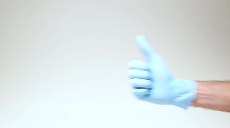 Male hand in medical glove on white background. Stock Footage