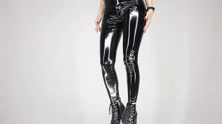 Leather shiny pants on a sexy girl close-up Stock mozgókép