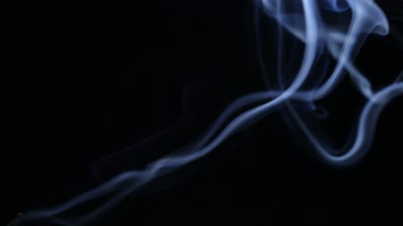 Aroma sticks smoke close up on black background