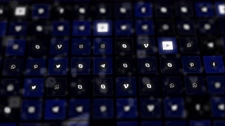 Chernivtsi, Ukraine - June 19, 2019: Dark-blue blurred and glittering background video presenting social media logos.