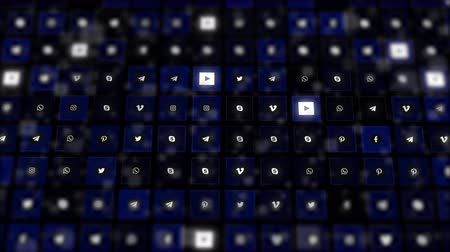 боке : Chernivtsi, Ukraine - June 19, 2019: Dark-blue bokeh layers and gridded composition of social channels logos.