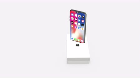 šedé pozadí : Chernivtsi, Ukraine - July 11, 2019: Brand new generation of Apple iPhone 11 with box, isolated on white background. 4K.