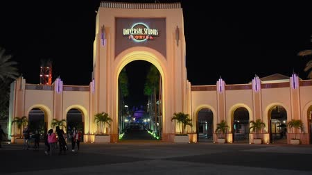 universal studios : Orlando, Florida. April 18, 2019. Universal Studios arch on night background at Citywalk. Stock Footage