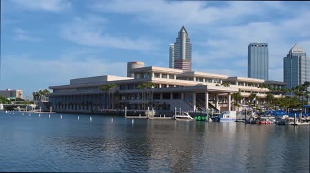 tampa bay : Tampa Bay, Florida. April 30, 2019. Panoramic view of Convention Center and colorful boats on lightblue sky background.