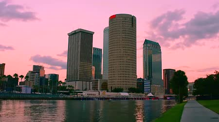 スクーター : Tampa, Florida. March 23, 2019.Time Elapsed of Downtown Skyscrapers on colorful sunset background.