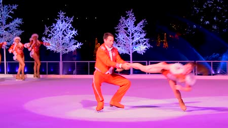 skate : Orlando, Florida. December 25, 2018. Orlando, Florida. December 25, 2018. Couple skating on ice at Winter Wonderland on Ice show in International Drive area.